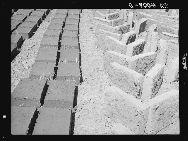 Adobe bricks drying in the sun. Bernalillo County, New Mexico