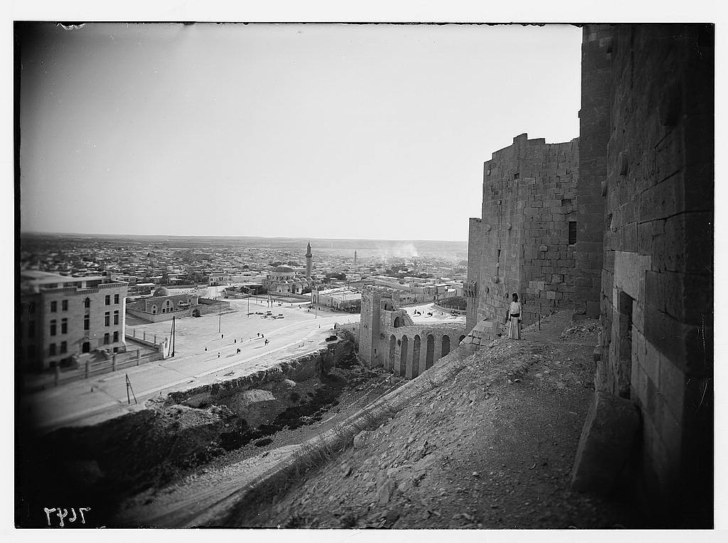 Aleppo from the castle showing moat & entrance