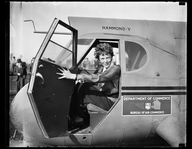 [Amelia Earhart in airplane]