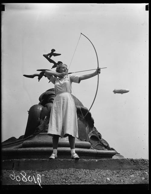 [Archery, Goodyear blimp in background. Washington, D.C.]