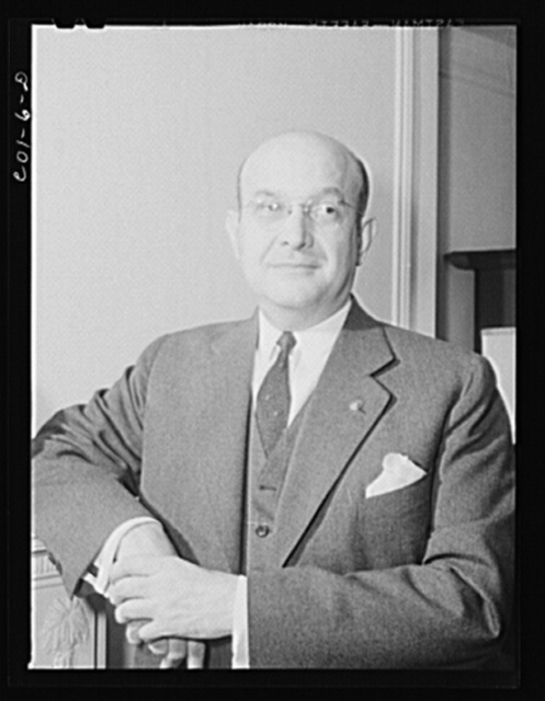 Assistant Secretary of War Louis A. Johnson(?) photographed in his home. Washington, D.C.