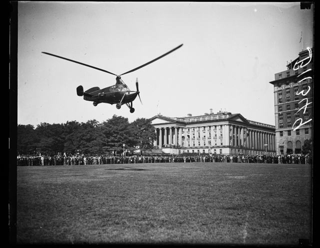 Autogiro lands near U.S. Treasury, Washington, D.C. Oct. 2. A new type autogiro thousands of city folks may be parking in the yards or on the roofs of apartment houses in is shown about to land near the U.S. Treasury. The ship was flown to Washington by James G. Ray, veteran autogiro pilot, for delivery to the Bureau of Air Commerce, Department of Commerce, who will make several acceptance test flights