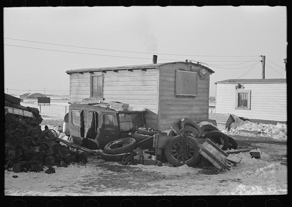 """Backyard of shack in """"Shantytown,"""" Spencer, Iowa"""