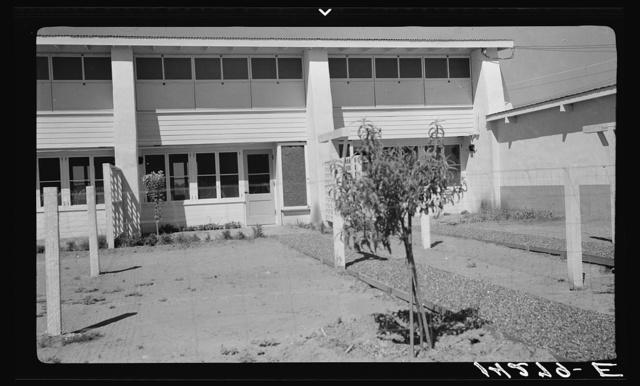 Backyard view of community building. Adobe construction. Chandler tract, Arizona