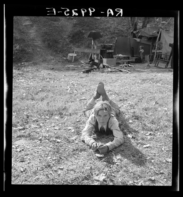 "Boy, fourteen, in eighth grade. Now unable to attend because of insufficient food and clothing. Subsisted two days on frozen tomatoes from field nearby. Father said ""They call me a road hog and a bum; but if I am, how did that boy get into the eighth grade?"" American River camp, near Sacramento, California"