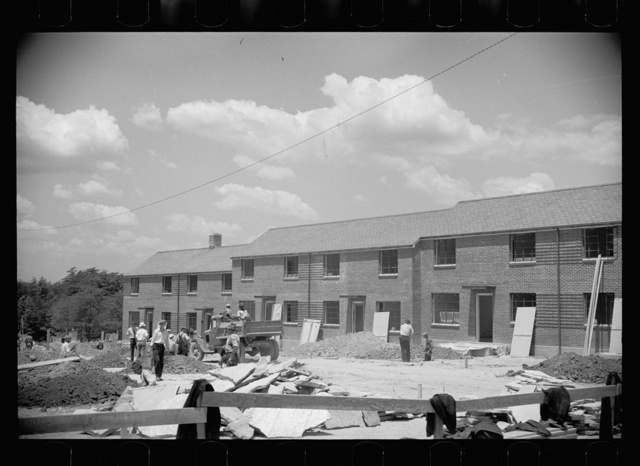 Brick-veneer house nearing completion, Greenbelt, Maryland