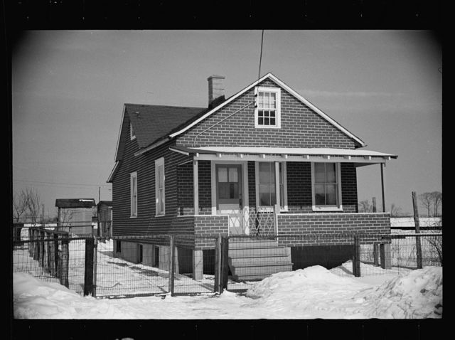 Cheap false brick tarpaper-covered wooden house typical of subdivision sections in Franklin Township, Amwell Road, West New Brunswick near Derussey land, New Jersey