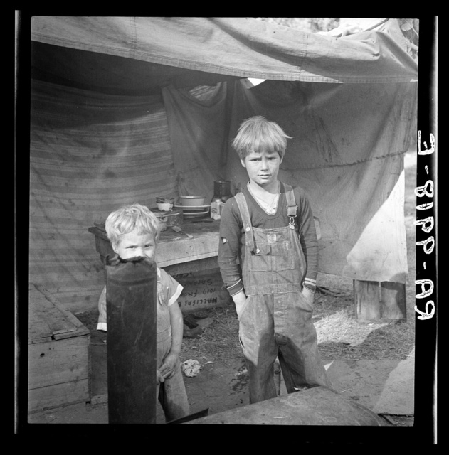 Children of destitute family. American River camp, near Sacramento, California