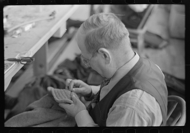 Closeup of tailor in garment factory, Jersey Homesteads, Hightstown, New Jersey