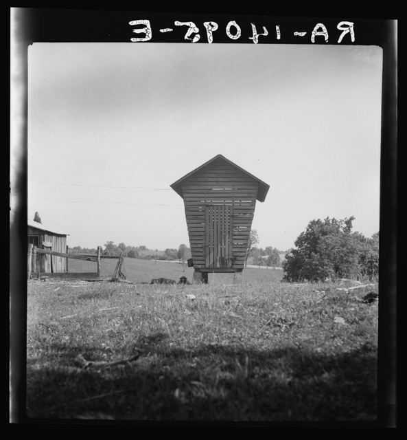 Corn crib near Bartlett, West Virginia. Typically-formed crib, following shape of southeastern American Indian crib but adapted in materials by European colonists. This crib with typically flaring sides, found commonly in Michigan and Ohio