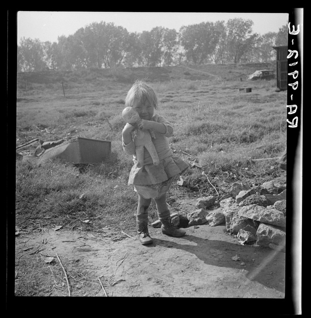 Daughter of a migrant fruit worker. American River camp outside of Sacramento, California