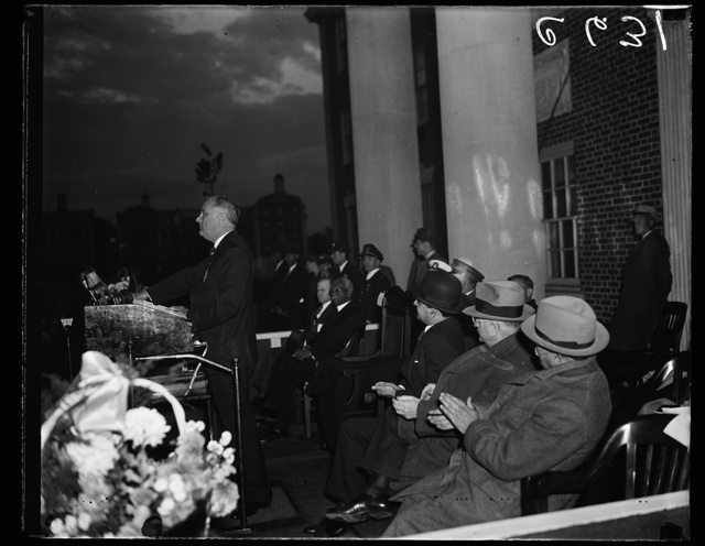 DEDICATES NEW CHEMISTRY BUILDING AT HOWARD UNIVERSITY. PRESIDENT ROOSEVELT DELIVERING THE PRINCIPAL ADDRESS AS THE NEW $625,000 CHEMISTRY ERECTED BY THE PWA FOR HOWARD UNIVERSITY WAS DEDICATED TODAY. L TO R: PRESIDENT ROOSEVELT; DR. MORDECAI JOHNSON, PRESIDENT OF HOWARD UNIVERSITY; AND PWA ADMINISTRATOR HAROLD ICKES