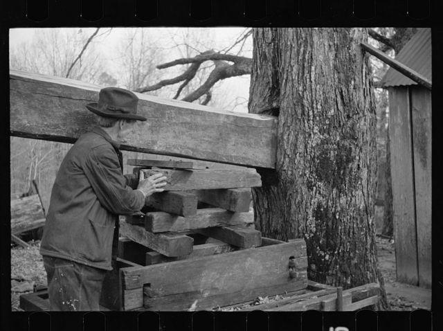 Demonstrating homemade cider press at Crabtree Recreational Demonstration Area near Raleigh, North Carolina