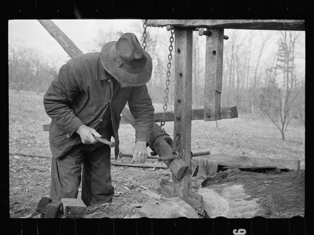 Demonstrating homemade cider press at Crabtree Recreational Demonstration Project near Raleigh, North Carolina