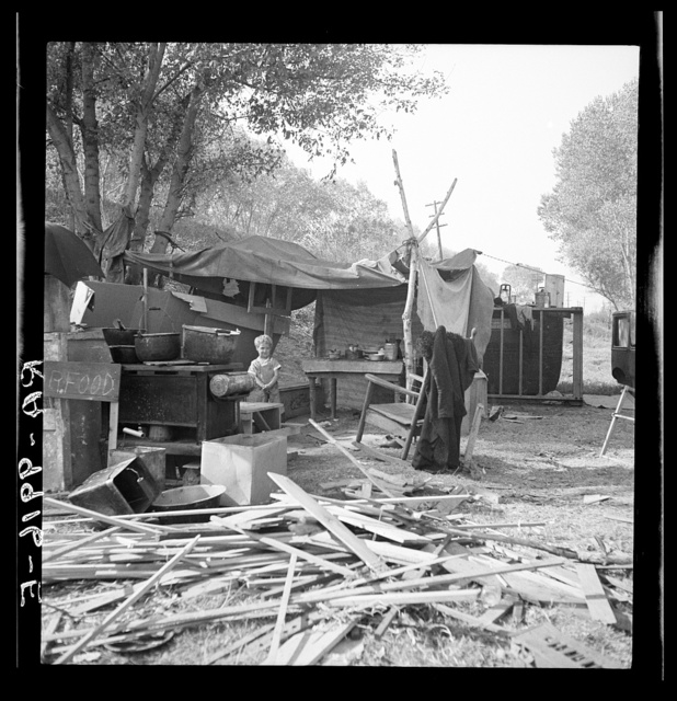 Destitute family. American River camp, Sacramento, California