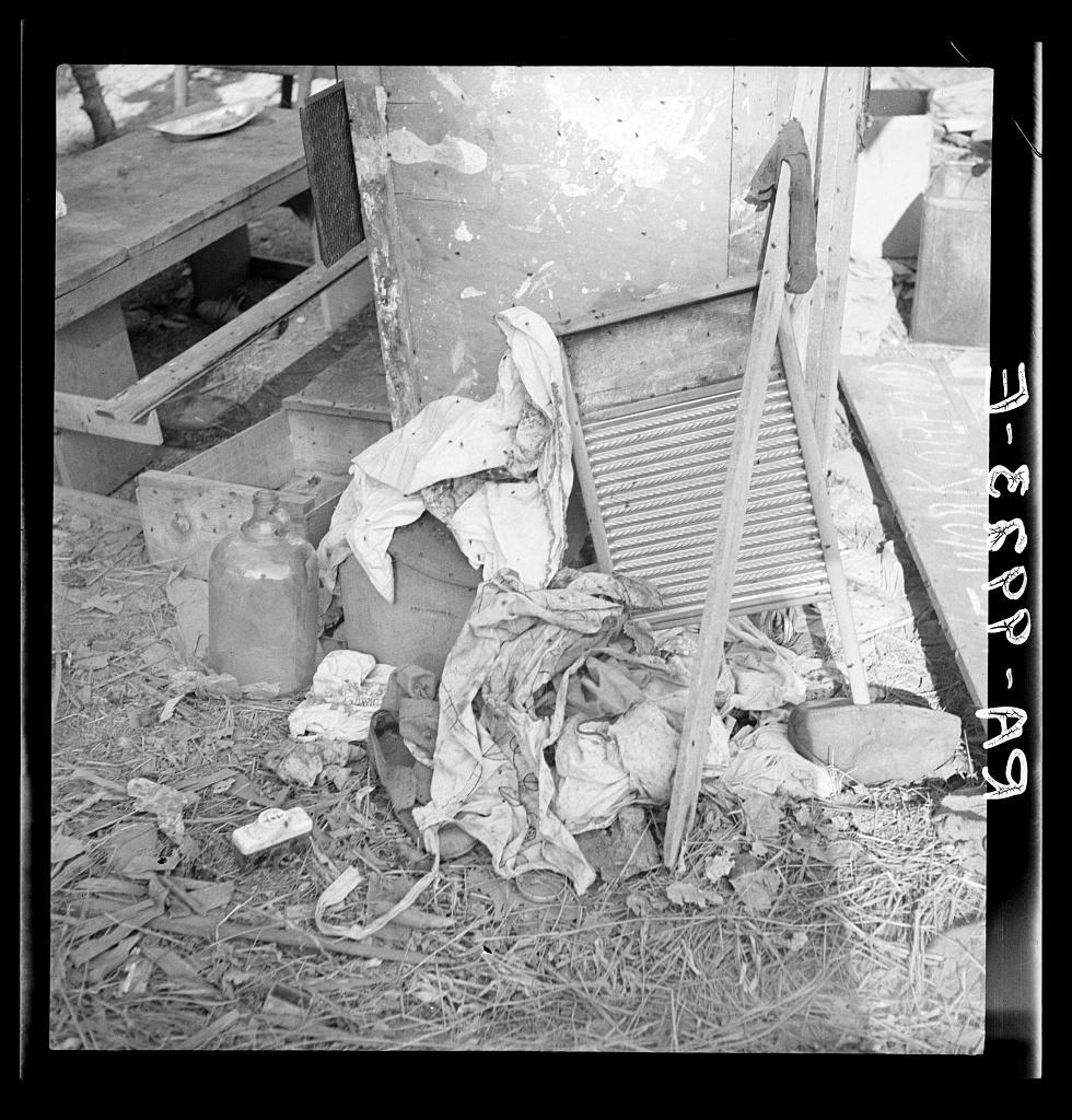 Dirty clothes and flies. American River camp, near Sacramento, California