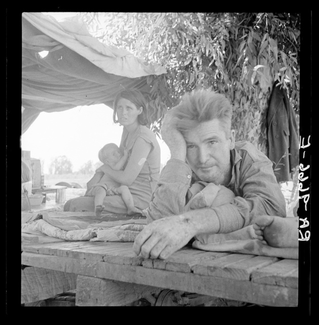 Drought refugees from Oklahoma camping by the roadside. They hope to work in the cotton fields. There are seven in family. Blythe, California