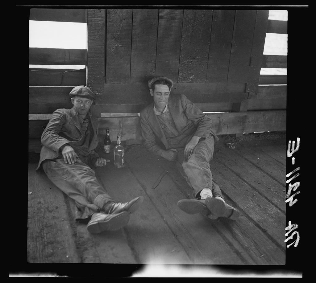 Drovers at rest in stockyards. Kansas City, Kansas