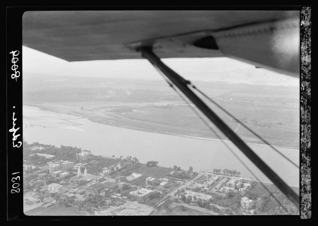 Egypt. Thebes to southern border of Egypt. Air view. Edfu, showing the newer town, Nile, and fields beyond