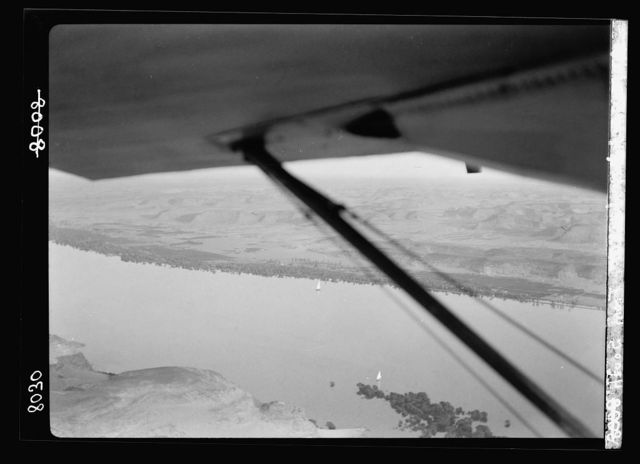 Egypt. Thebes to southern border of Egypt. Air view. Looking down on the Nile between Luxor and Edfu