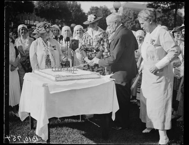 [Eleanor Roosevelt and group; cake cutting]