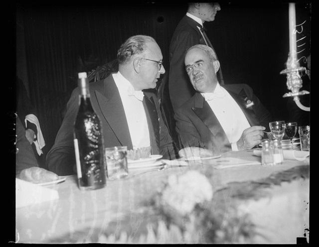 Electrician and Irrigator, Washington, D.C., September 11. Senor Don Enrique Gongors, Chief of the Research of Irrigation of Lima, Peru, speaks to Morris L. Cooke, Chief of the World Power Conference Banquet held at Union Station