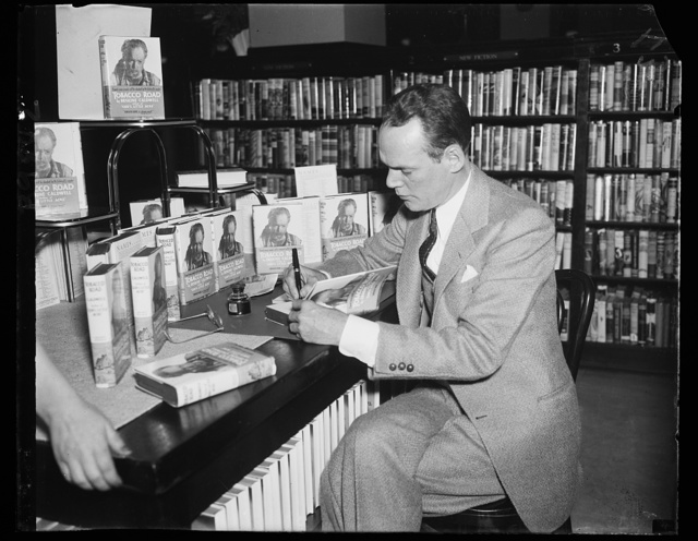 "[Erskine Caldwell signing copies of book ""Tobacco Road""]"