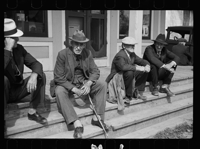 Fair at Albany, Vermont. The old timers take to the steps of the general store