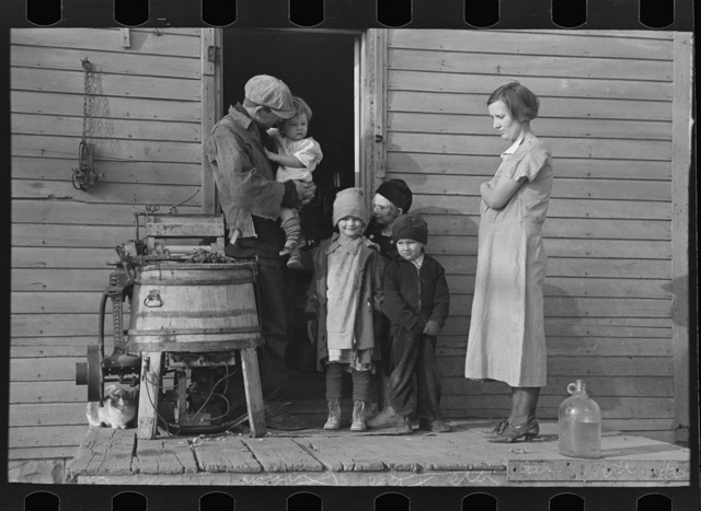 Family of Glen Cook, who rents his farm from a loan company. Cook's livestock has been cut down considerably due to lack of feed. Little Sioux township, Woodbury County, Iowa