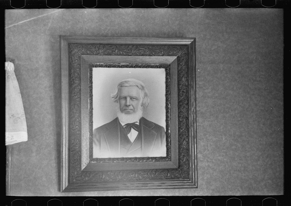 Family portrait in home of Fred Rowe, farmer near Estherville, Iowa
