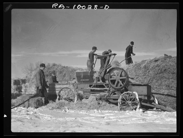 Farmers baling straw. Clay County, Iowa