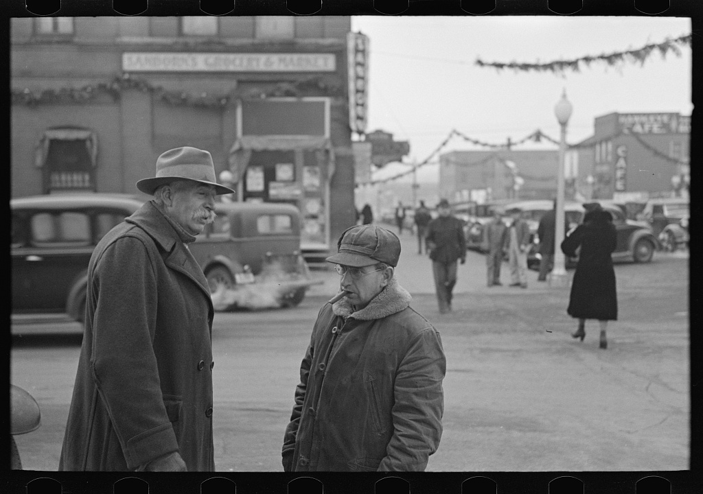 Farmers in town, Estherville, Iowa