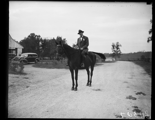 FHA head out for a canter, Washington, D.C. Sept. 29. Stewart McDonald, Federal Housing Administrator, gets his daily exercise astride his favorite mount. He is shown ready for an early morning canter thru Rock Creek Park