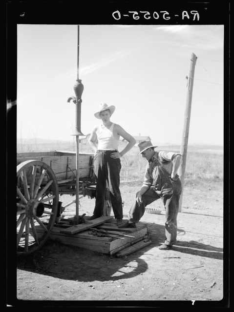 Fixing a dried well on the farm of Mrs. Emma Knoll. Grant County, North Dakota