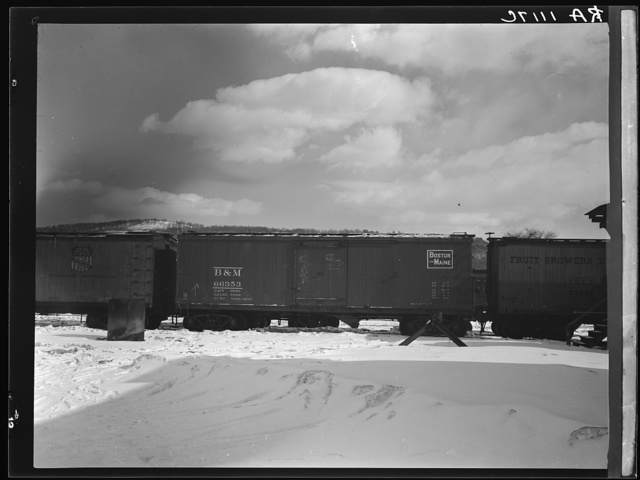 Freightcars in yards of farmers' cooperative. White River Junction, Vermont