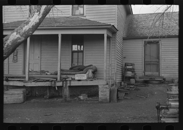 Front porch of house occupied by Mrs. Mary Kelsheiner and sons, Miller Township, Woodbury County, Iowa