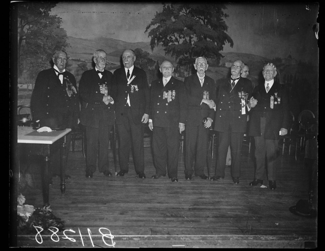 G.A.R. Commander-in-chief Ruhe and Staff, Washington, D.C. Sept. 24. Photo shows, left to right James W. Willett of Tama, La. Judge advocate general; Oley Nelson of Slater, Ia. retired commander-in-chief C.H. Wm. Ruhe of Wilkinsburg, Pa.; Thomas Ambrose of Chicago, Ill., Junior Vice Commander; John M. Kline of Wash. D.C.; George H. Pounder of Ft. Atkinson, Wis. Chief of Staff; and Robert M. Rownd of Ripley, N.Y. Inspector General