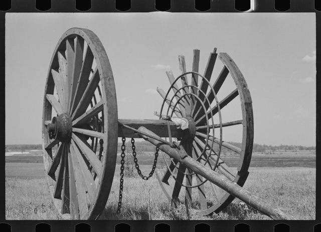 Giant wheels ten feet in diameter, once used for carrying logs to sawmill, Michigan