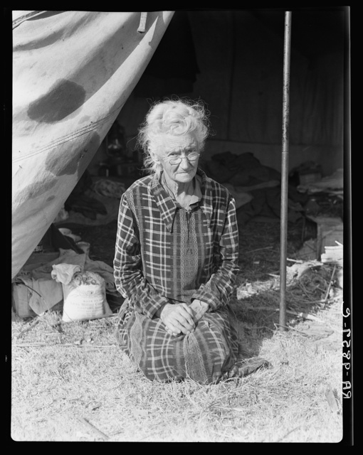 """Grandmother of twenty-two children, from a farm in Oklahoma; eighty years old. Now living in camp on the outskirts of Bakersfield, California. """"If you lose your pluck you lose the most there is in you - all you've got to live with"""""""