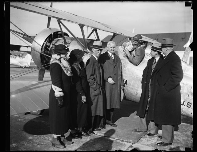 [Group at airplane; Jesse H. Jones, center]