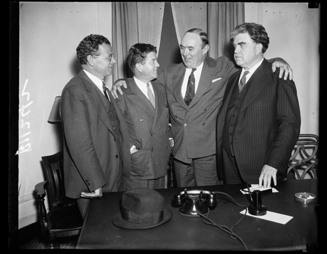 [Group: Robert M. LaFollette, Jr., 2nd from left; John L. Lewis on right]