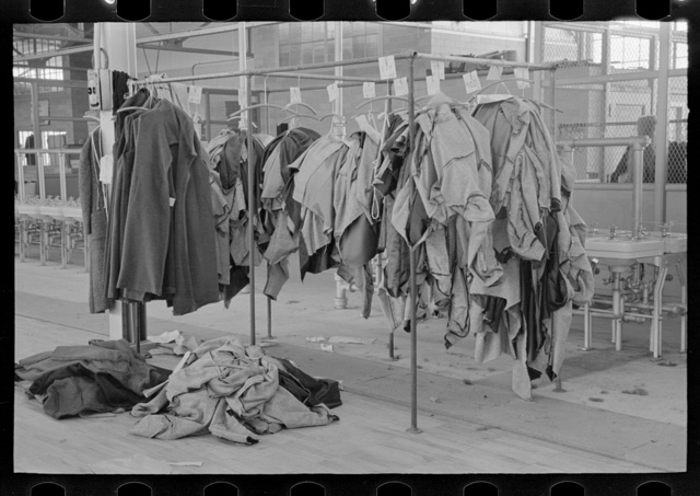 Half-made garments on the racks, awaiting final operations of the machines, in cooperative garment factory, Hightstown, New Jersey