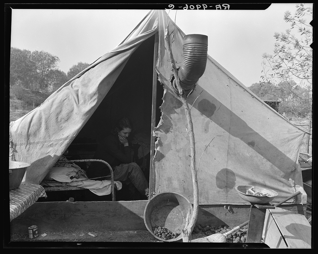 """Home of Tennessee family of seven, now migratory workers living in camp outside of Sacramento, California. Father was coal miner in Tennessee but when the mines were not working received two days a week relief work. """"Thought we could make it better out here"""""""