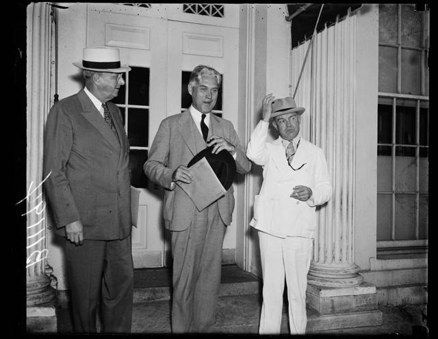 [Homer S. Cummings, left; Harry Woodring, right]