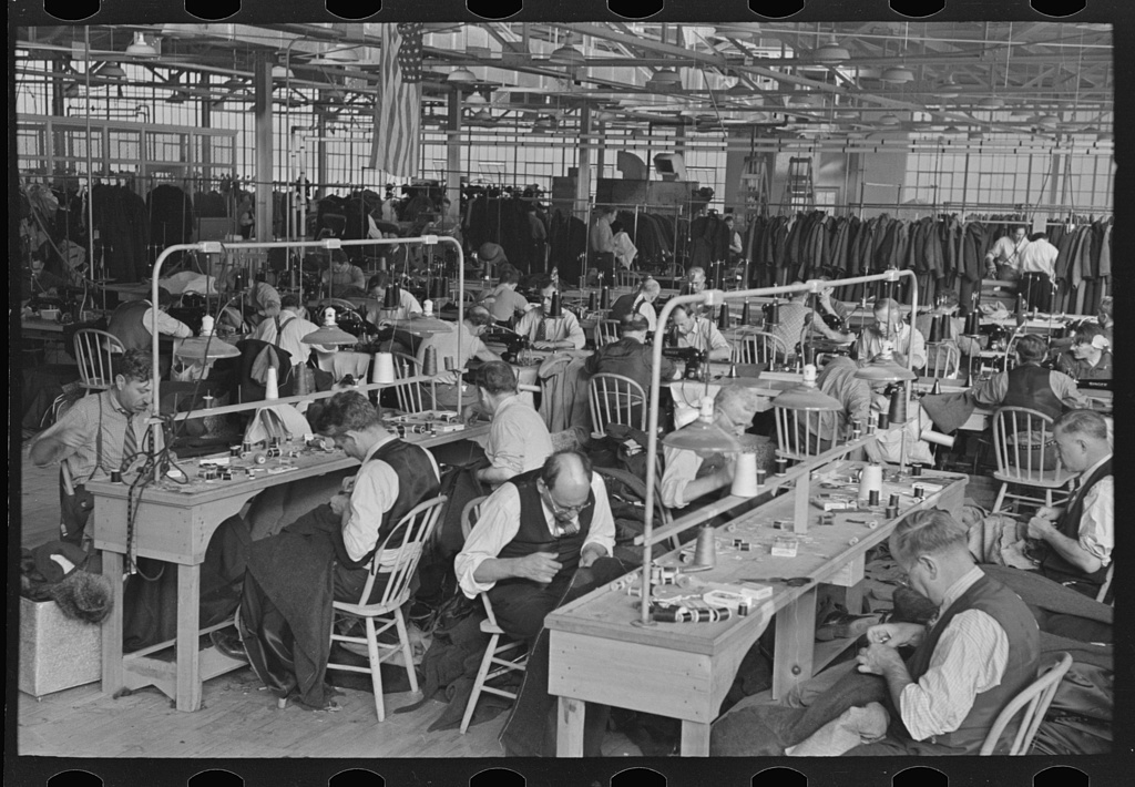 Interior of cooperative garment factory at Jersey Homesteads, showing some of eighty homesteaders at their work and some of the ladies' coats made by them. Hightstown, New Jersey