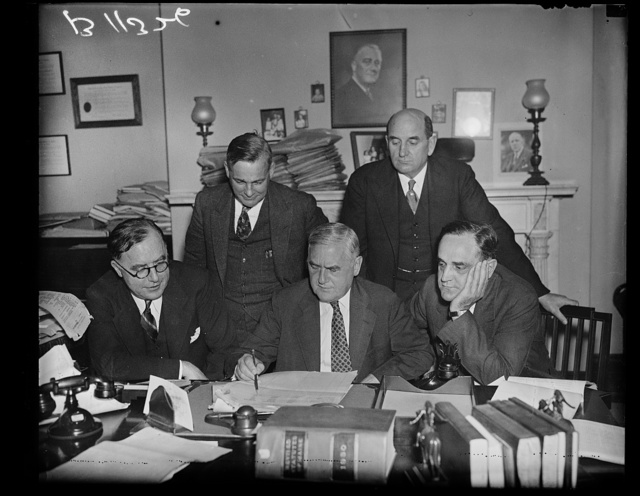 Investigating presidential campaign expenses, Washington, D.C., Sept. 30. The campaign expenses of the presidential candidates are being carefully scrutinized by this special Senate Committee of which Senator Augustine Longergan, Democrat, is chairman. In the photograph made at the first meeting of the committee today are left to right: (seated) Sen. Louis B. Swellenbach, Democrat of Washington, Senator Augustine Longergan, Connecticut, and Senator Sherman Minton, Democrat of Indiana. Standing, left to right, Walter Meyers, counsel to the committee, and Senator Lynn J. Frazier, Farmer-Labor from North Dakota