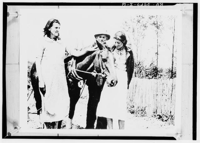 """Jena, Louisiana. Paul J. Green and his wife and one of their daughters with the horse which they received from the Rural Settlement Administration after they had worked their small plot by pulling their plow as """"human horses"""" for three years. Another daughter and a son make up the family of five which has been too proud to go on relief"""