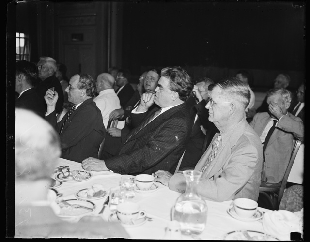 John L. Lewis listens to Smith, Washington, D.C., August 7. John L. Lewis listening to the Rev. Smith blast the New Deal at the Premiere Club in Washington today. Smith also professed that we would all see the day and thank Lewis for breaking away from the American Federation of Labor