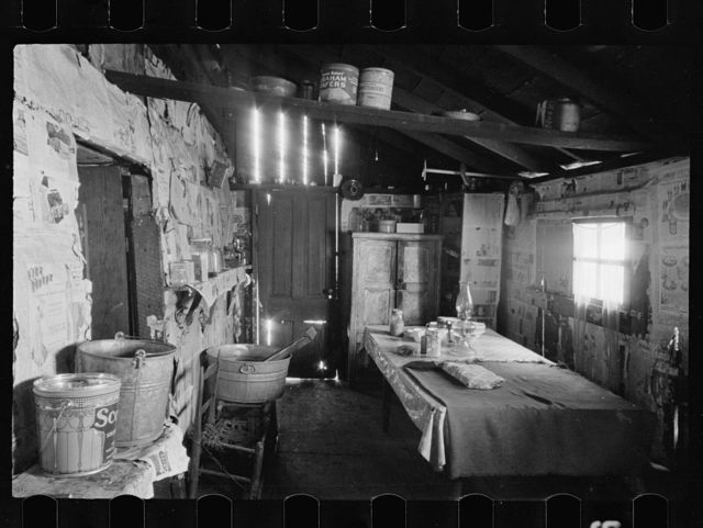 Kitchen and washroom of two room mountain shack, Route U.S. 11, a few miles east of Marshall, North Carolina