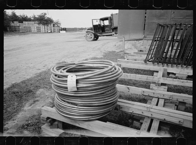 Lead pipe, plumbing fixture storage in background, Greenbelt, Maryland